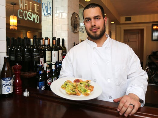 Executive Chef Anthony Rosario Jr. holds the Housemade
