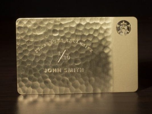 A real gold Starbucks Card gives coffee for life