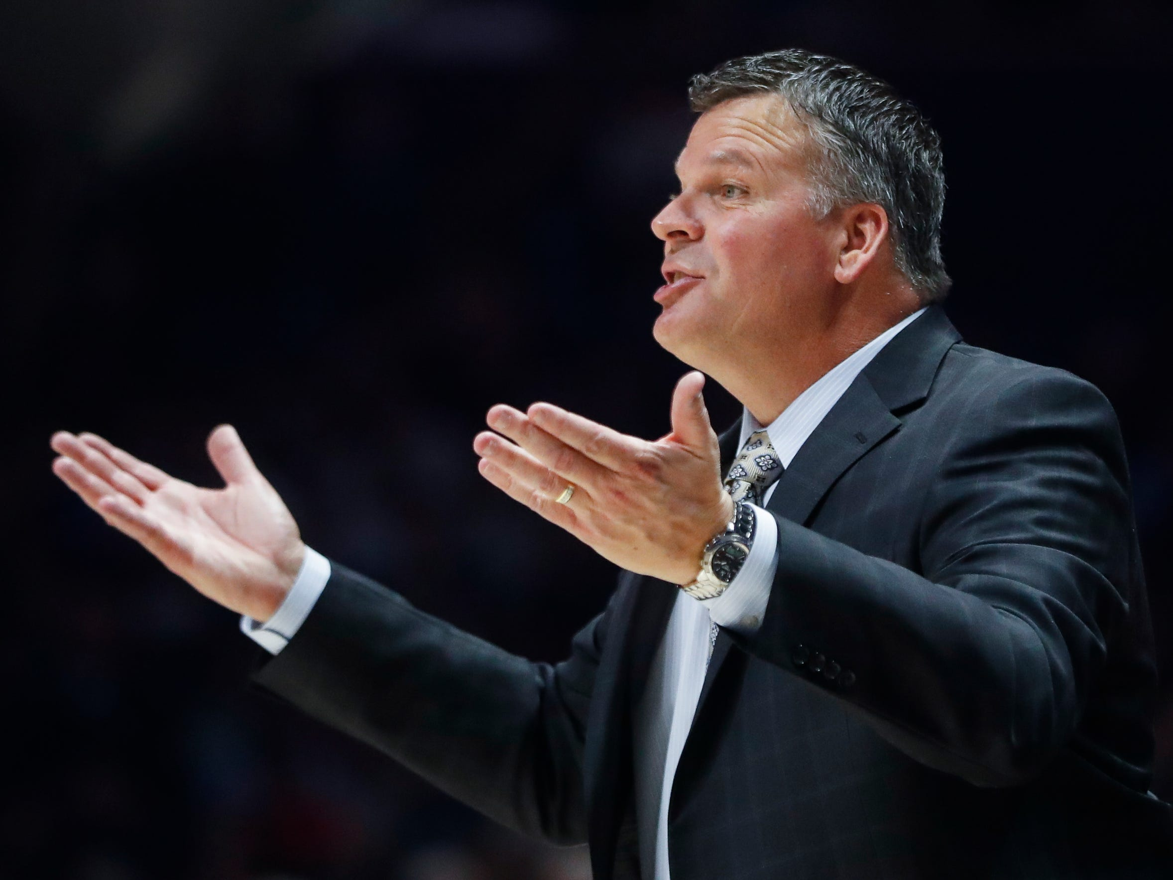 Creighton head men's basketball coach Greg McDermott directs his players from the bench in the first half of an NCAA college basketball game against Xavier on Jan. 13, 2018, in Cincinnati. (AP Photo/John Minchillo)
