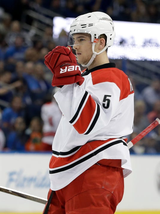 Carolina Hurricanes defenseman Noah Hanifin (5) pumps his fist after scoring against the Tampa Bay Lightning during the first period of an NHL hockey game Wednesday, March 1, 2017, in Tampa, Fla. (AP Photo/Chris O'Meara)