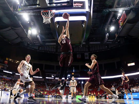 Cole Henry of Oskaloosa drives to the basket during the 3A semifinal game against Waverly Shell Rock at Wells Fargo Arena Thursday, March 8, 2018.