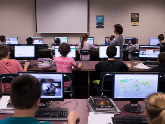 Christina Lawrence directs her sixth-grade Language Arts students in the computer lab at Castle North Middle School as they learn how to collect evidence to support non-fiction articles they read Wednesday morning.