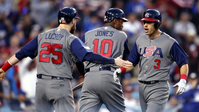 United States infielder Ian Kinsler, right, celebrates with teammates Jonathan Lucroy and Adam Jones after hitting a two-run home run in the third inning against Puerto Rico in the final of the World Baseball Classic at Dodger Stadium in Los Angeles on March 22, 2017.