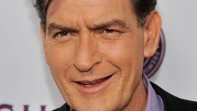 "Charlie Sheen, a cast member in ""Scary Movie V,"" poses at the Los Angeles premiere of the film at the Cinerama Dome on April 11, 2013 in Los Angeles.   A dental technician who says Sheen punched her in the chest during a September office visit is suing the actor for assault and battery."