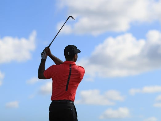 Tiger Woods warms up on the range prior to the final