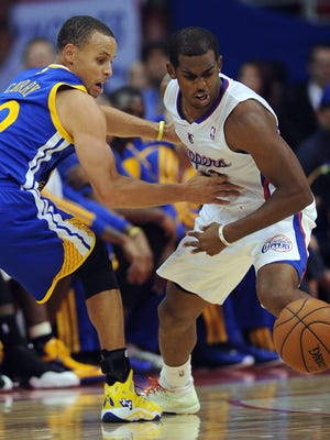 The Warriors' Stephen Curry, left, and Clippers' Chris Paul are two of the best point guard in the NBA.