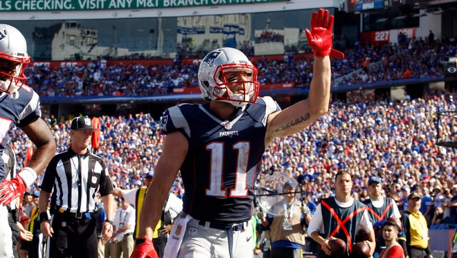 New England Patriots wide receiver Julian Edelman (11) celebrates his touchdown during the second half against the Buffalo Bills at Ralph Wilson Stadium.