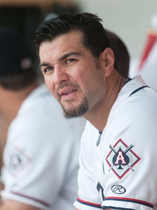 635974495307760879-Chavez-In-Dugout-Candid.JPG