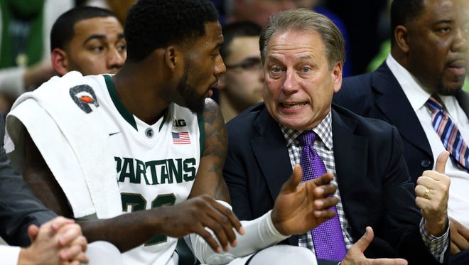 Michigan State forward Branden Dawson and head coach Tom Izzo talk on the bench against Arkansas-Pine Bluff at the Breslin Center.