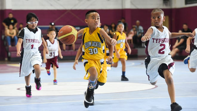 In this July 22 file photo, the Tamuning Typhoons took on the Dededo Yellowjackets in a Bank of Guam SummerJam Basketball Tournament 8-Under Division game at Tamuning Gym.