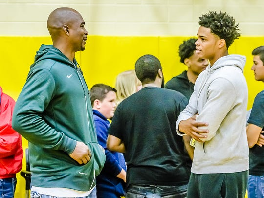 Miles Bridges, right, speaks with former MSU player and one of the original Flintstones, Antonio Smith, on Saturday.