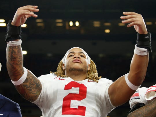 Dec 7, 2019; Indianapolis, IN, USA; Ohio State Buckeyes defensive end Chase Young (2) reacts after defeating the Wisconsin Badgers and winning the 2019 Big Ten Championship Game at Lucas Oil Stadium. Mandatory Credit: Brian Spurlock-USA TODAY Sports