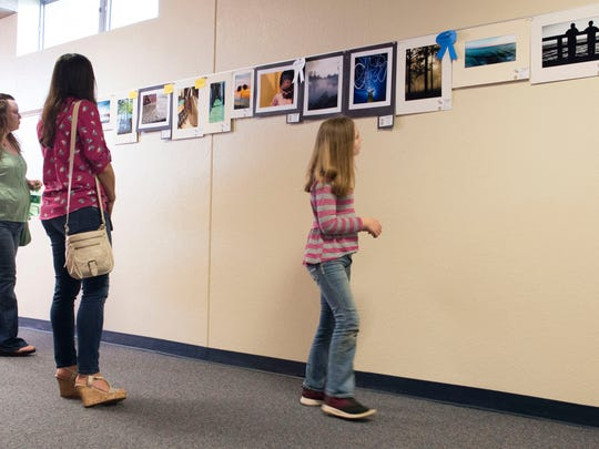 Parents, teachers, school district staff and art lovers, gets a look at the at on display in the 58th Bright Images Exhibition at the J.E Hall Center in Pensacola Thursday evening. The annual art show features hundreds of works of art created Escambia County School District students.