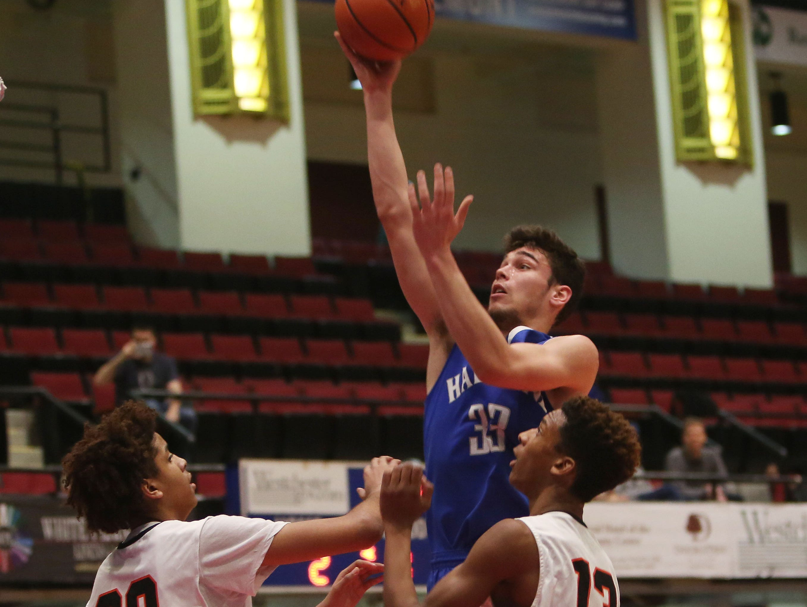 Haldane's Will Zuvic (33) goes up for a shot in front of Tuckahoe's Bryan Murray (30) and Alexander Williams (13) during first half action in the boys Class C semifinal at the Westchester County Center in White Plains Feb. 24, 2016. Haldane won the game 44-34.