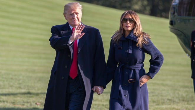 President Trump and first lady Melania Trump return to White House March 19, 2018, after attending an event in Manchester, N.H.on the opioid epidemic.
