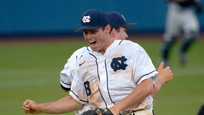 North Carolina's Parks Jordan (8) and Landon Lassiter, rear, celebrate after defeating Florida 5-2 in an NCAA college baseball regional tournament game in Gainesville, Fla.
