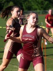 Riverdale's Jenna Wyckoff hands the baton off to Hannah