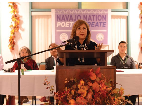 Navajo Nation poet laureate Dr. Laura Tohe at her induction ceremony recites  a poem she wrote. The ceremony was held Sept. 11 at Navajo Technical University in Crownpoint.