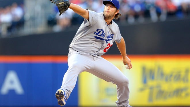Dodgers starting pitcher Clayton Kershaw pitches against the Mets .