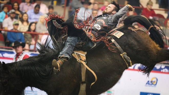 Logan Patterson rides bareback during the 9th performance of the San Angelo Stock Show and Rodeo Wednesday, Feb. 14, 2018, at Foster Communications Coliseum.