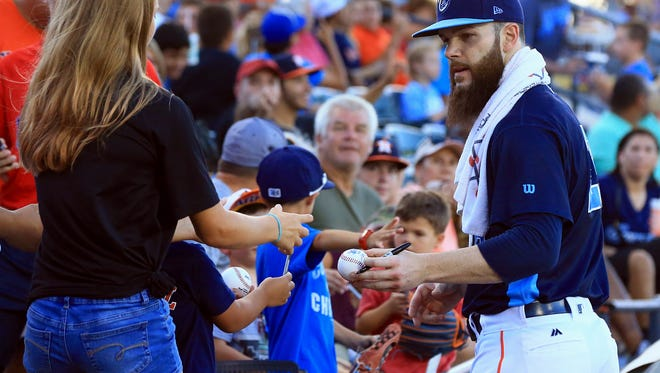 Hooks' Dallas Keuchel signs an autograph for a fan on Monday, July, 17, 2017, at Whataburger Field in Corpus Christi. Houston Astros Dallas Keuchel started rehabilitation with the Hooks.