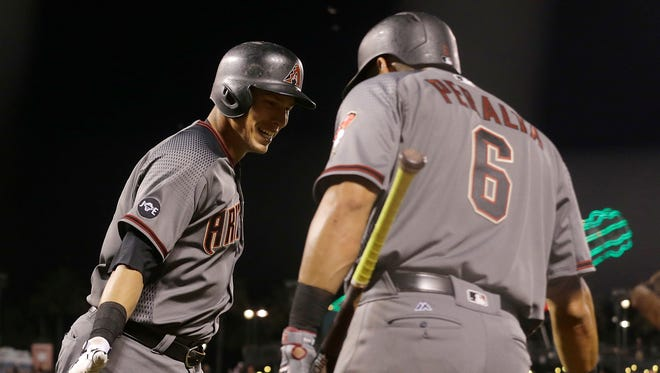 Arizona Diamondbacks' Jake Lamb, left, celebrates with David Peralta after hitting a solo home run against the San Francisco Giants during the ninth inning of a baseball game in San Francisco, Monday, April 18, 2016.
