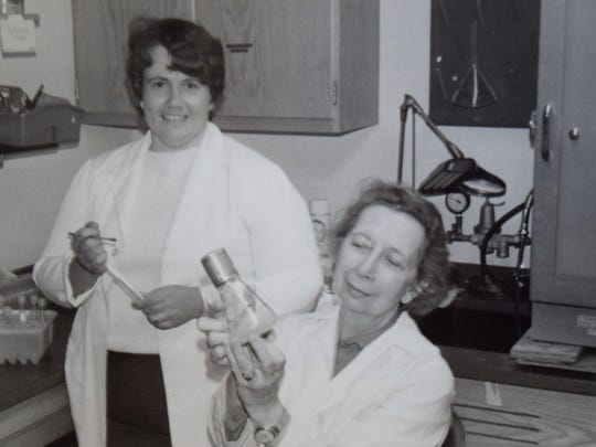 Dr. Mariafranca Morselli, right, botany professor, University of Vermont from 1964-1988 and Lynn Whalen investigated many aspects of the microbiology of maple sap and syrup. They were responsible for early work related to processing technology (RO, UV lights) and their impact on syrup quality.