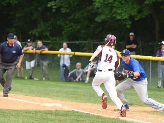 Park Ridge #14 Tyler Marsh gets on first base Park