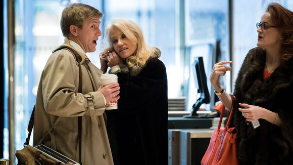 Republican political strategists Nick Ayers (left) and Kellyanne Conway arrive at Trump Tower in New York on Thursday, Dec. 8, 2016. President-elect Donald Trump and his transition team are in the process of filling Cabinet and other high-level positions in the new administration.