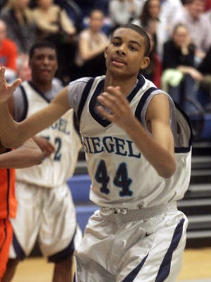 Former Siegel basketball player Neal Carroll III is shown during a 2006 game. Carroll, who had a heart transplant in 2005, died last week from complications involving the heart.