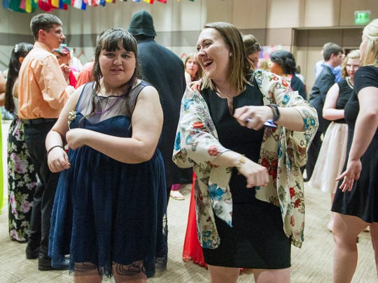 Chelsea Gaddis, right, dances with Alissa Givens from