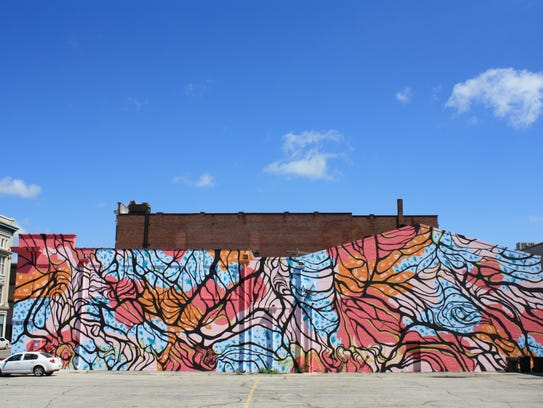 The mural on the side of the Mark III Tap Room in downtown