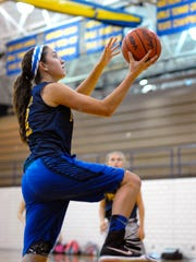 Jenna Koppinger goes up for a layup, Monday, Nov. 9,