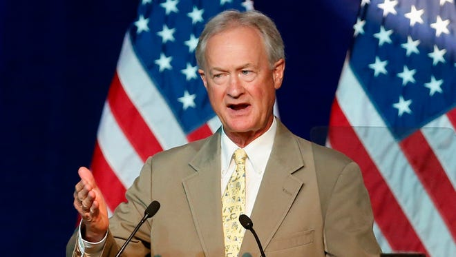 FILE - In this Aug. 28, 2015 file photo, Democratic presidential candidate, former Rhode Island Gov. Lincoln Chafee speaks in Minneapolis. The Republican presidential contest has been aflutter for months, with all that preening and cackling from an overcrowded colony of rivals. Now it's time for the Democrats to spread their wings before a big national audience, with their first debate, Tuesday night. (AP Photo/Jim Mone, File)