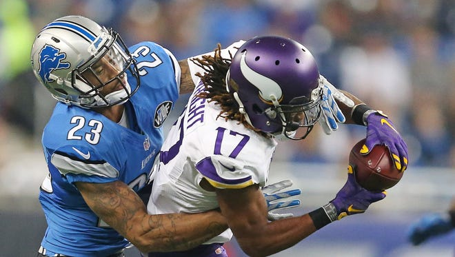 Minnesota Vikings wide receiver Jarius Wright (17) picks a first down on this catch over Detroit Lions cornerback Darius Slay (23) during the second quarter on Sunday, Oct. 25, 2015, at Ford Field in Detroit.