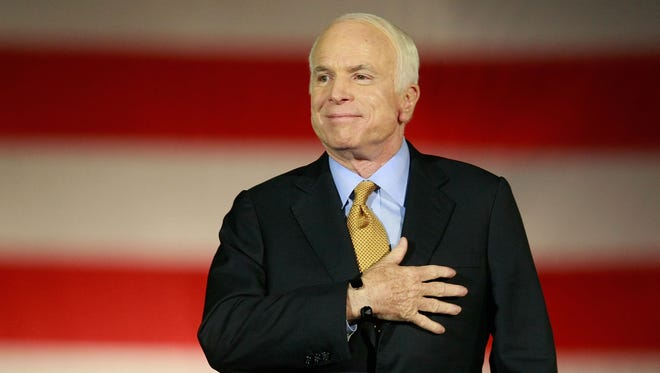 Republican presidential nominee U.S. Sen. John McCain concedes victory on stage during the election night rally at the Arizona Biltmore Resort & Spa on Nov. 4, 2008, in Phoenix.