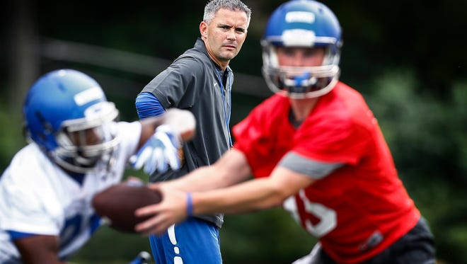 University of Memphis head football coach Mike Norvell (middle) intently watches drills during the first day of practice Friday afternoon.