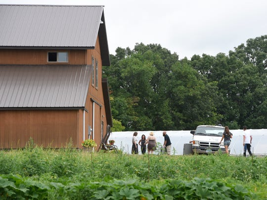 People gather near the barn at Baker's Acres Sunday