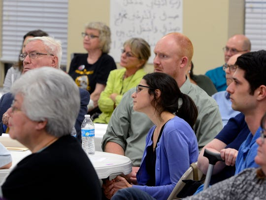 Visitors listen to Imam Hosny Ibrahim speak  Saturday night during the Islamic Center of Northwest Florida's open house.