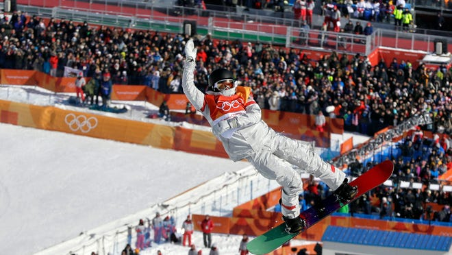 Kelly Clark, of the United States, jumps during the women's halfpipe finals at Phoenix Snow Park at the 2018 Winter Olympics in Pyeongchang, South Korea, Tuesday, Feb. 13, 2018. (AP Photo/Kin Cheung)
