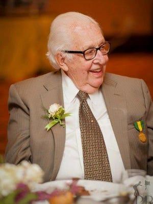 Burlington philanthropist and businessman Tony Pomerleau enjoys a light moment in this undated photo.