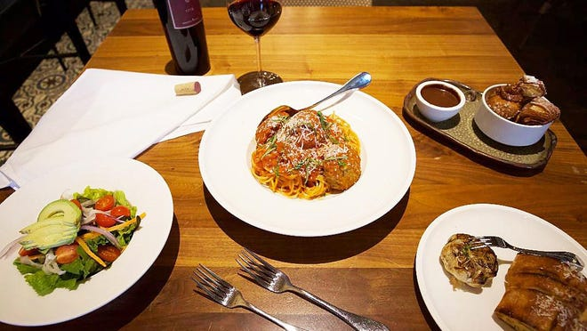 Cucina's spaghetti-and-meatballs dinner for five people includes salad, garlic bread and New Orleans-style beignets for dessert. You can add a bottle of select wine for $15.