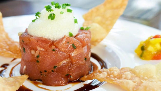 At Meat Market, executive chef Sean Brasel's picks for lighter dishes include tuna tartare brightened with ginger and other aromatics.