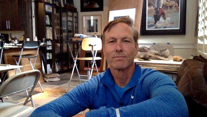 """Artist Frank Hyer is one of the founders of """"Art Through The Looking Glass"""" project, which plans to fill vacant storefront windows in downtown Portsmouth with visual art exhibits for curbside viewing. Above, he's seen in his studio on Bow Street in Portsmouth."""