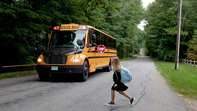 Allison McCusker, 9, walks to get on the school bus on the first day of the fall semester earlier this month in Union.