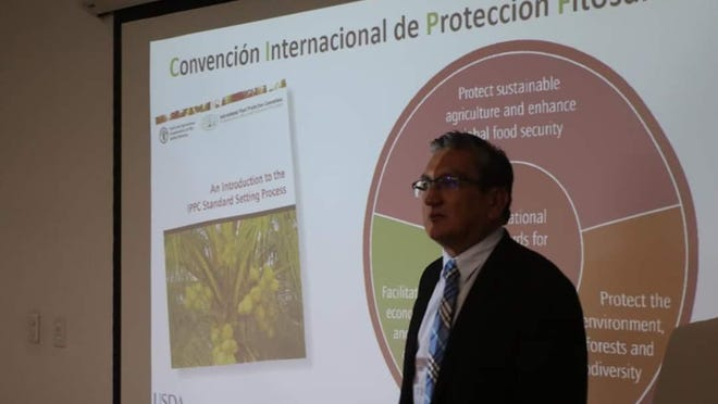 Texas Tech researcher Marcos Sanchez-Plata provides instruction to food safety officials in Colombia to help them meet the requirements of the Food Safety Modernization Act, which will allow them to export food to the U.S.