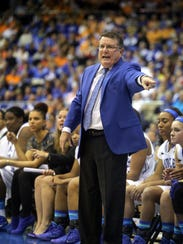 MTSU's head coach Rick Insell instructs his team from