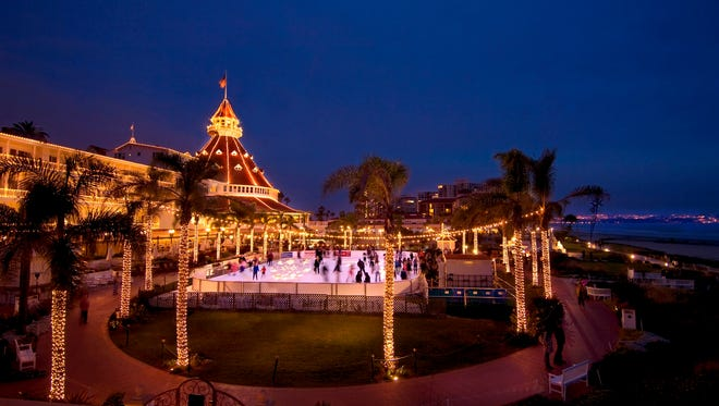 Skaters can spin by the sea at the Hotel Del Coronado in San Diego, where palm trees strung with lights surround the outdoor ice rink.