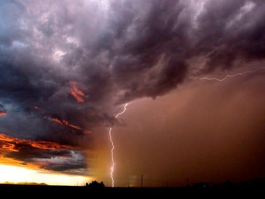A monsoon storm moves over Scottsdale towards Phoenix