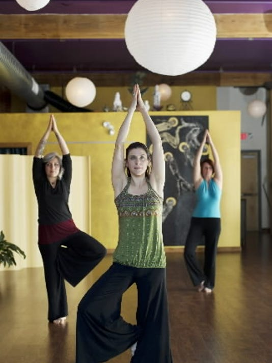 Megan Donley of Lotus Moon Yoga in York, center, will host free yoga classes July 16, July 23 and July 30 outside at the York Daily Record for No Sweat in the Park.